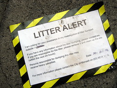 Big joke; council litter alert sign thrown on the street by business across the road