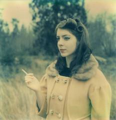 Martha with a cigarette. (ayatsato) Tags: seattle portrait polaroid martha magnolia discoverypark postwar sonarsx70 artistictz