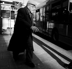Running late (Ian Brumpton) Tags: street portrait urban blackandwhite bw london square blackwhite noiretblanc pavement candid streetphotography highcontrast angleterre shadowplay contrejour decisivemoment londonbus cricklewood pensioner londonist streetphotographer runninglate enretard londonstreetphotography lifeinslowmotion scattidistrada