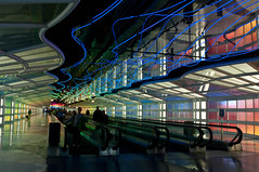 The Concourse (idashum) Tags: travel people chicago lights airport nikon united tunnel terminal ohare neonlights escalators ord ida chicagoohare travelers shum movingwalkway d300 ohareairport skysthelimit nikonflickraward nikonflickrawardgold idashum unitedtunnel