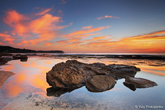 Reflections (-yury-) Tags: ocean morning sea cloud reflection water sunrise still rocks sydney australia calm bungan