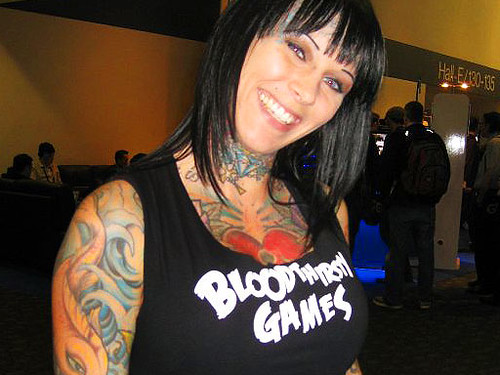 Michelle McGee full of body tattoos and top with the words Blood Thirsty Games