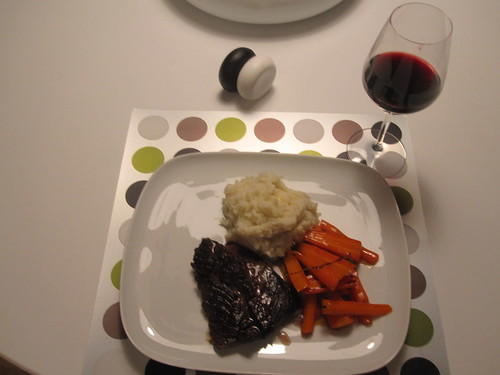 Steak, glazed carrots, mashed potatoes, wine