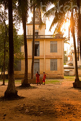 Monks having a chat outside a french-colonial building in the late afternoon sun | Kandal Province, Cambodia (bokehcambodia) Tags: sunset building architecture asian temple pagoda chat cambodia cambodian khmer robe religion group colonial talk monk buddhism monks palmtree sunlit talking wat chatting oldbuilding saffron settingsun twomonks novice twoman saffronrobes frenchcolonial