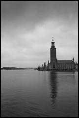 (Georgios Karamanis) Tags: bridge sea sky bw white black reflection building water clouds sweden stockholm cityhall stadshuset karamanis