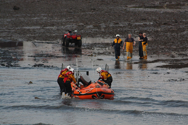 The RNLI landing their hard-hulled rescue vessel at Anstruther harbour.