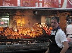 parrilla (micmol ) Tags: food man cooking horizontal uruguay fire adult beef cook sausage meat roast grill apron pork ribs montevideo protein caucasian