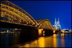 Kln - Klner Dom and Hohenzollern Bridge (Yen Baet) Tags: travel bridge blue architecture reflections germany deutschland gold europe cathedral spires postcard religion gothic cologne kln destination christianity bluehour catholicism rhein rhineriver klnerdom starbursts twinspires hohenzollernbrcke famouslandmark hohenzollernbridge twililght classicshot germanchurches churchesofeurope churchesingermany grosstmartin cathedralingermany greatstmartinschurch bridgesofeurope