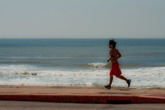 (matt.harding) Tags: blue sky man galveston beach gulfofmexico water nikon surf texas may running seawall shorts jogging curb 2010 d90