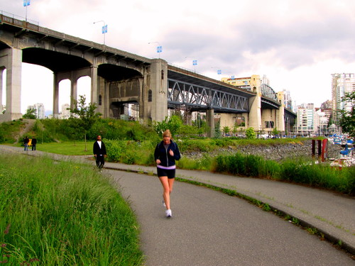 Jogger runs on Vancouver's Burrard Street Bridge land that will be developed by Squamish Nation
