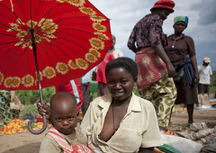 Mother and son with umbrella at market, Rwanda (Eric Lafforgue) Tags: africa baby smile um