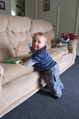 "Thomas ""cruising"" around the furniture"
