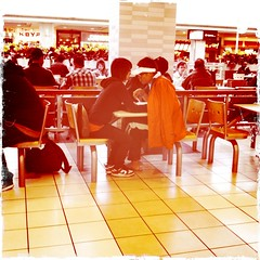 Awkwardly Close (Sixth Lie) Tags: cameraphone food mall lunch couple close chairs eating crowd young teens sneakers tiles stc awkward creeper foodcourt tooclose washedout iphone weirdlight scarboroughtowncentre