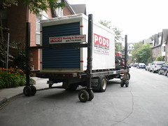 Unloading a shipping container with household ...