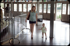_MG_0767-57 (k.a. gilbert) Tags: park baby walking lucy toddler shoes legs daughter mother naturallight carousel indoors sissy kristen wife handheld heels inside milf dansko slater pawtucket slaterpark looff tamron1750mmf28
