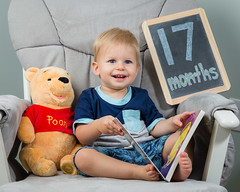 17 Months (zachary.locks) Tags: 17 bear book chair happy jack monthly months pooh reading sitting smile son toddler winnie