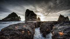 Motukiekie Revisited (Bradley Grove) Tags: clouds landscape monolith ocean orange rocks sea seascape stacks starfish storm tempest tide westcoast newzealand 064