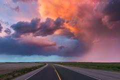 Surreal Storm Sunset (Matt Grans Photography) Tags: sunset wyoming storm light twilight clouds road vanishingpoint