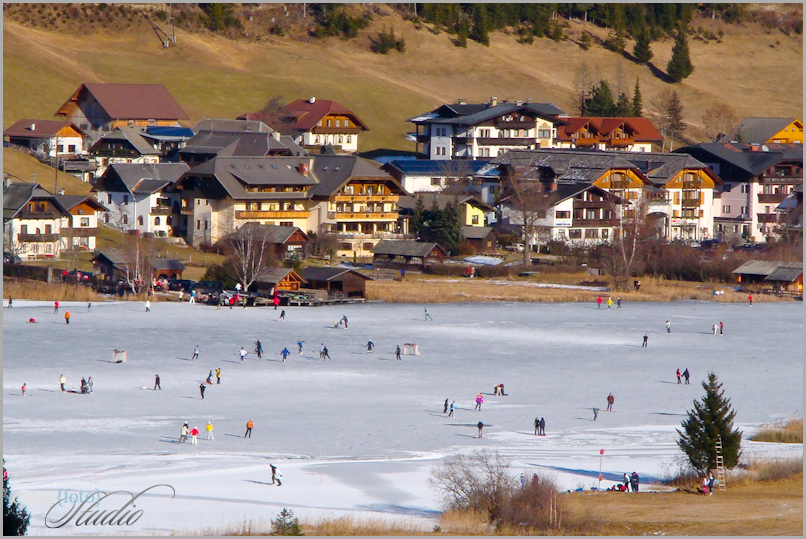 Skaters on ice of the lake