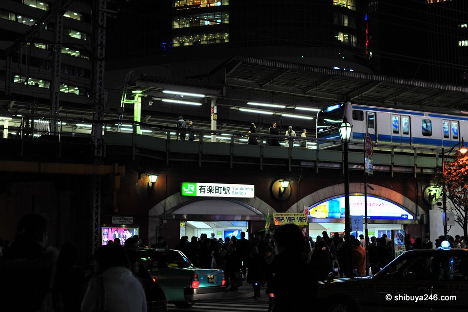 Yurakucho Station with people bustling about on Xmas Eve.