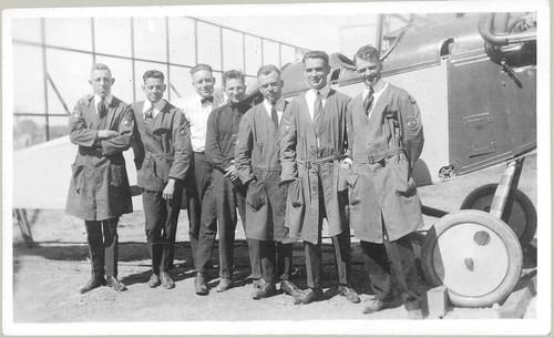 Biplane under construction with ground crew