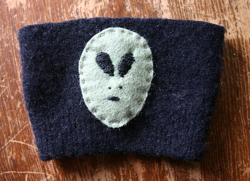 Alien coffee sleeve thingy