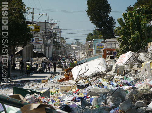 Piles of garbage and debris spill onto the street