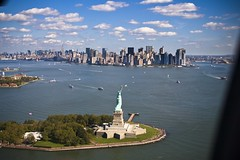 NYC From above XVI (Massi) Tags: above nyc autumn summer sky usa sun ny newyork statue clouds america canon liberty eos manhattan flight scenic panoramic helicopter 30d