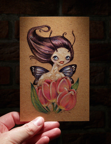 Postcard of Pixie with tulips