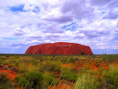 Uluru or Ayers Rock (kees straver (will be back online soon friends)) Tags: trees sunset sun tree water rock clouds sunrise landscape sand rocks desert nt australia darwin crocodile outback uluru katatjuta northernterritory blueskys ayersrock greengrass whiteclouds redstone highgrass theoutback keesstraver