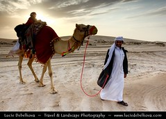 Qatar - Camel and its driver passing accros desert at sunset ( Lucie Debelkova / www.luciedebelkova.com) Tags: world trip travel light sunset vacation holiday man tourism animal landscape outdoors person sand tour place desert sightseeing scenic middleeast visit location tourist camel human journey arabia destination sight traveling visiting exploration landschaft touring gcc qatar magiclight luciedebelkova wwwluciedebelkovacom