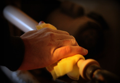 nate's hand on the wood lathe