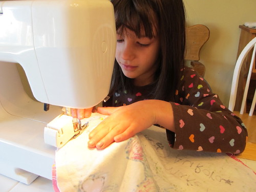 Lil' Mermaid sewing the horse pillow present