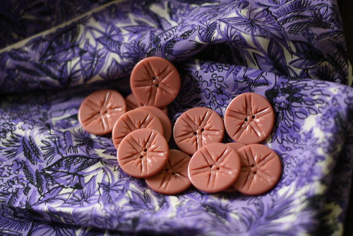 purple fabric, pink buttons