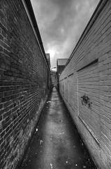 Alleyway, High Wycombe (IFM Photographic) Tags: blackandwhite bw monochrome canon vanishingpoint blackwhite buckinghamshire perspective tamron bucks wycombe highwycombe leighstreet 450d 1024mm sp1024mmf3545 img048456tonemappedbw desboroughavenue