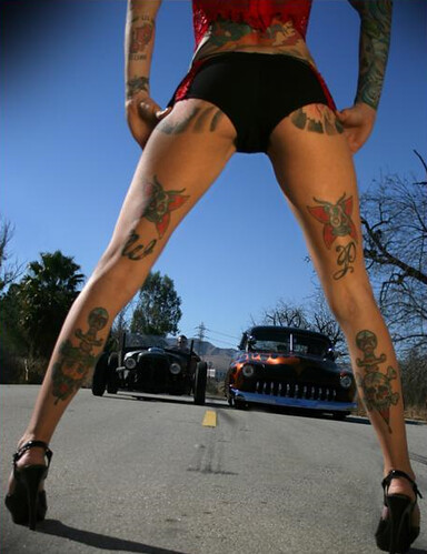 Michelle Bombshell McGee full of tattoos poses in the funniest way,