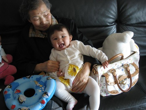 with her great grandmother and a Louis Vuitton bag