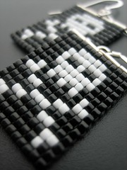 Thar be earrings! (pardalote flits) Tags: white black silly fun goth pirate earrings geeky jollyroger beadwork beadweaving squarestitch