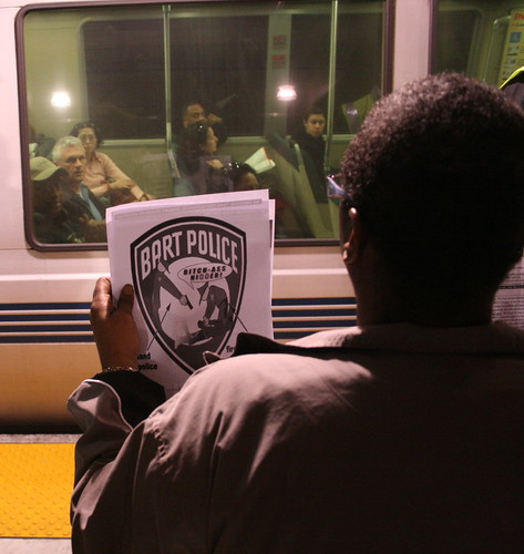 BART protester holds up sign for passengers