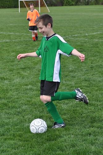 """Giggles"" dribbles the soccer ball"