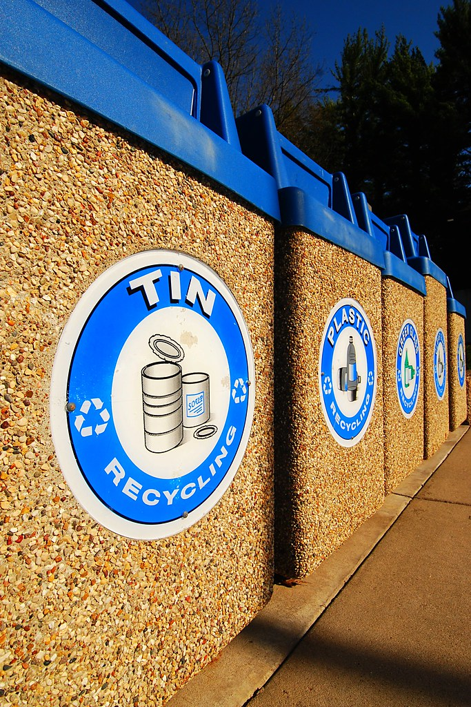 Blue and yellow stone recycling bins.