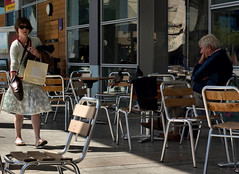 In a hurry (lovestruck.) Tags: city uk summer england people man west coffee girl shopping bristol walking geotagged cafe sitting candid tables hurry 2009 milleniumsquare rushing sigma105macro pentaxk10d geo:lat=51450226 geo:lon=2599975