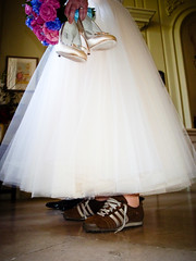 Sneakers and wedding dress (longboy74) Tags: portrait color colour weddingdress 2010 pictureaday afterthevows lowanglephotography adidastrainers andbreathe nigelvickywedding holdingdressshoes