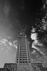 In the Clouds (Bruce Bordelon) Tags: white black building monochrome clouds skyscraper silver rouge nikon louisiana downtown capitol pro tall d200 nikkor f28 baton stste efex 1424mm
