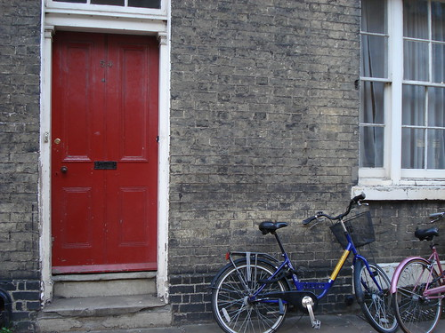Red door with bike(s)