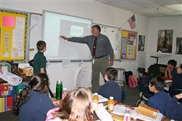 Fifth Grade teacher Doug Schoemer instructs his students about their Google Earth assignment.