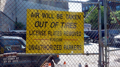 Air will be let out of tires and license plates removed from unauthorized parkers sign, Greenwich Village, NYC, NY, USA by gruntzooki