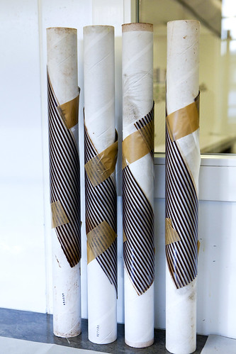 Chocolate stripes set into heavy tubes to create chocolate spirals
