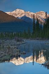 Mountain reflections (Richard Boyle) Tags: light snow canada reflection sunrise early still peaceful calm alberta banff banffnationalpark vermillionlakes