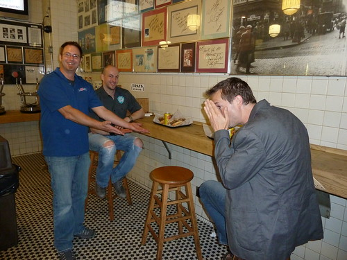 Later night at Jim's Steaks Bill Covaleski showcases our cheesesteaks as James Watt looks on & Greg Koch tries to hide his face